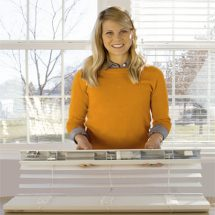 lady-holding-up-automated-blinds